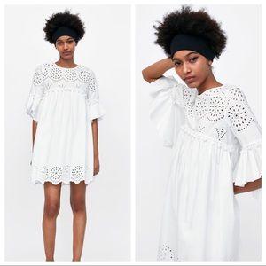 NWT. Zara White embroiled dress. Size M.